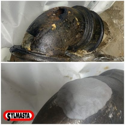 A large crack in a cast iron pipe is repaired using Superfast Steel