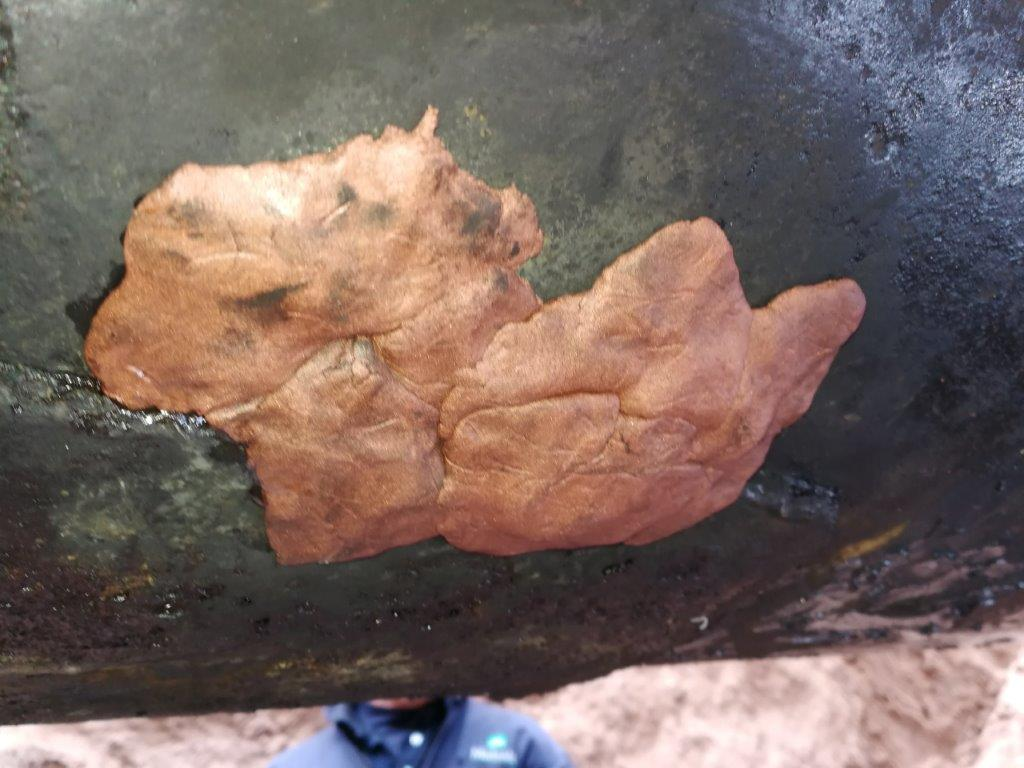 Superfast Copper Epoxy Putty applied to a leaking steel pipe in an oil well